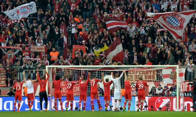 Bayern's players celebrate with supporters after the Champions League quarterfinal second leg soccer match between Bayern Munich and Manchester United in the Allianz Arena in Munich, Germany, Wednesday, April 9, 2014. Munich defeated Manchester by 3-1. (AP Photo/Kerstin Joensson)