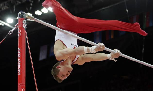 U.S. gymnast Jonathan Horton performs on the horizontal bar during the artistic gymnastics men's apparatus finals at the 2012 Summer Olympics, Tuesday, Aug. 7, 2012, in London.  (AP Photo/Gregory Bull)