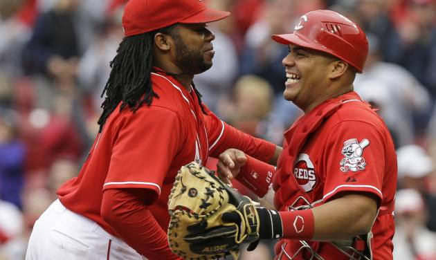 Cincinnati Reds catcher Brayan Pena, right, congratulates starting pitcher Johnny Cueto after the Reds defeated the San Diego Padres 5-0 in a baseball game, Thursday, May 15, 2014, in Cincinnati. Cueto pitched a complete game, three-hit, shutout.  (AP Photo/Al Behrman)