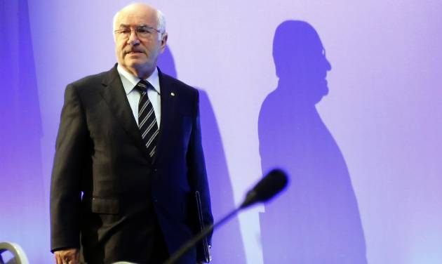 Italian Soccer Federation (FIGC) newly elected president Carlo Tavecchio arrives for the national elective assembly in Fiumicino, near Rome, Monday, Aug. 11, 2014. (AP Photo/Riccardo De Luca)
