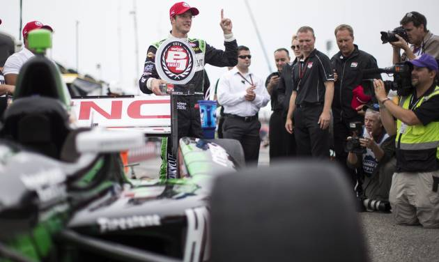 France's Sebastien Bourdais, centre, celebrates qualifying in pole position for first race of a weekend doubleheader at the IndyCar auto race in Toronto on Saturday, July 19, 2014.  (AP Photo/The Canadian Press, Frank Gunn)