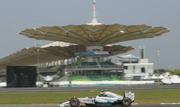 Mercedes driver Nico Rosberg of Germany steers his car during the first practice session for Sunday's Malaysian Formula One Grand Prix at Sepang International Circuit in Sepang, Malaysia, Friday, March 28, 2014. (AP Photo/Peter Lim)