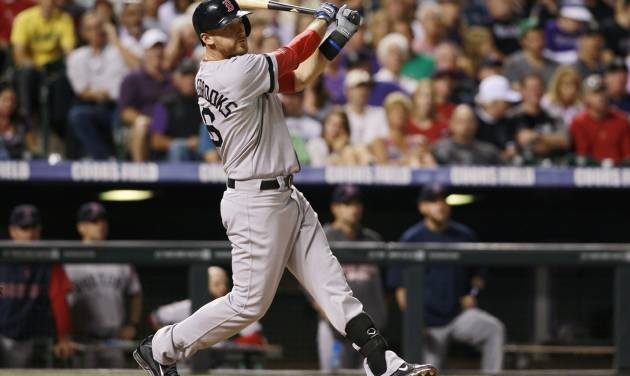 Boston Red Sox's Will Middlebrooks follows the flight of his three-run home run against the Colorado Rockies in the fifth inning of the Red Sox's 15-5 victory in a baseball game in Denver on Wednesday, Sept. 25, 2013. (AP Photo/David Zalubowski)