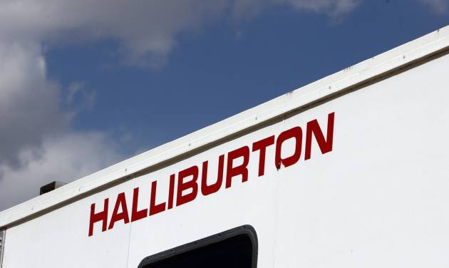 FILE - In this April 15, 2009, file photo, the Halliburton sign adorns the side of a machine being used by the company at a site for natural-gas producer Williams in Rulison, Colo. Halliburton reports quarterly earnings on Tuesday, Jan. 21, 2013 (AP Photo/David Zalubowski, File)