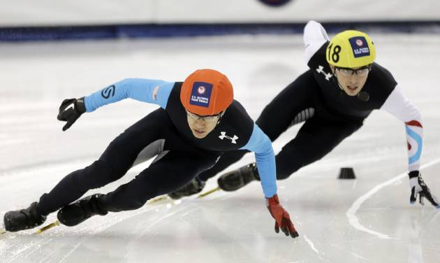 J.R. Celski, left, and Kyle Carr, right, competes in the men's 1,500 meters during the U.S. Olympic short track trials, Friday, Jan. 3, 2014, in Kearns, Utah. (AP Photo/Rick Bowmer)