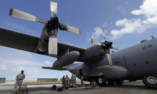 FILE - In this Feb. 7, 2013 file photo, members of the 374th Airlift Wing of U.S. Air Force work on a C-130 aircraft during the Cope North military exercises at Andersen U.S. Air Force Base in Guam. There soon will be another military element to life on the U.S. territory  _ a defense system will be installed to shoot down incoming missiles and warheads. Its deployment comes amid intensifying threats from North Korea, which recently listed Guam among its targets for a nuclear attack on the United States. (AP Photo/Koji Ueda, File)