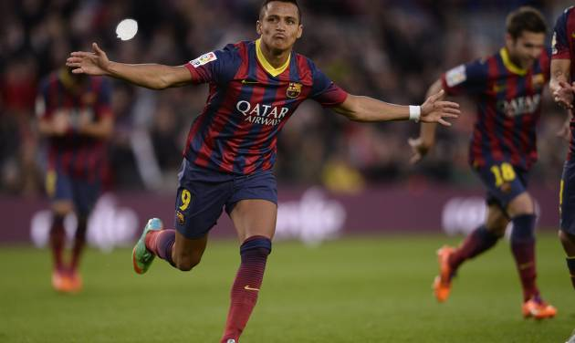 FC Barcelona's Alexis Sanchez, from Chile, reacts after scoring against Elche during a Spanish La Liga soccer match at the Camp Nou stadium in Barcelona, Spain, Sunday, Jan 5, 2014. (AP Photo/Manu Fernandez)