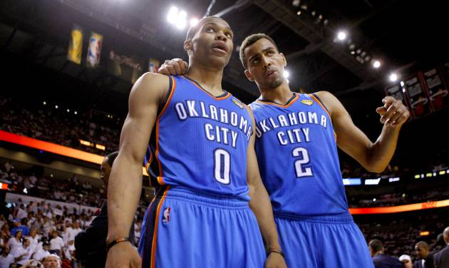 NBA BASKETBALL: Oklahoma City's Russell Westbrook (0) and Thabo Sefolosha (2) talk during Game 4 of the NBA Finals between the Oklahoma City Thunder and the Miami Heat at American Airlines Arena, Tuesday, June 19, 2012. Photo by Bryan Terry, The Oklahoman