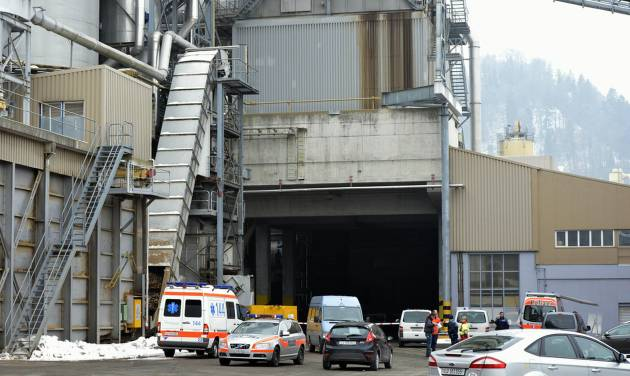 "Police stand in front of a wood-processing company in Menznau, central Switzerland, Wednesday, Feb. 27, 2013, where several people were killed in a shooting. Police in Lucerne canton (state) said in a statement that the shooting occurred shortly after 9 a.m. at the premises of Kronospan, a company in the small town west of Lucerne. They said there were ""several dead and several seriously injured people"" and that rescue services were deployed and the scene sealed off. (AP Photo/Keystone, Urs Flueeler)"