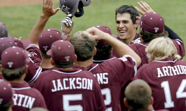 Texas A&M's Matt Juengel, center, celebrates with teammates after hitting a home run against Texas on Saturday. A conference realignment into the SEC would greatly impact the Aggies and many other baseball programs in the Big 12. PHOTO BY BRYAN TERRY, THE OKLAHOMAN