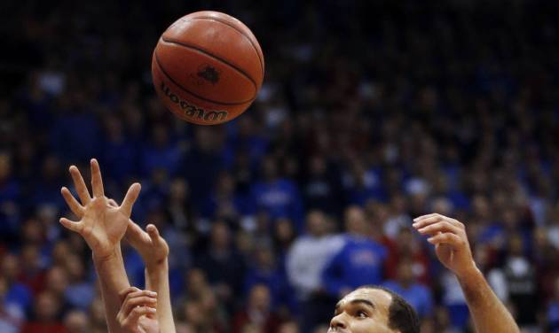 Kansas forward Perry Ellis (34) and Iowa State forward Georges Niang reach for a rebound during the first half of an NCAA college basketball game in Lawrence, Kan., Wednesday, Jan. 29, 2014. (AP Photo/Orlin Wagner)