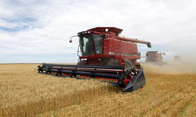 FILE - In this July 9, 2009 file photo three combines harvest the winter wheat on the Cooksey farm near Roggen, Colo. Farm-state lawmakers are pushing for final passage of the massive, five-year farm bill as it heads to the House floor Wednesday — member by member, vote by vote. There are goodies scattered through the bill for members from all regions of the country: a boost in money for crop insurance popular in the Midwest; higher cotton and rice subsidies for Southern farmers; renewal of federal land payments for Western states. There are cuts to the food stamp program — $800 million a year, or around 1 percent — for Republicans who say the program is spending too much money, but they are low enough that some Democrats will support them.  (AP Photo/Ed Andrieski, File)