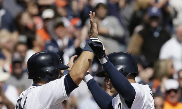 Detroit Tigers' Ian Kinsler, right, is congratulated by teammate Alex Avila after Kinsler's two-run home run during the fifth inning of a baseball game against the Cleveland Indians in Detroit, Thursday, April 17, 2014. (AP Photo/Carlos Osorio)