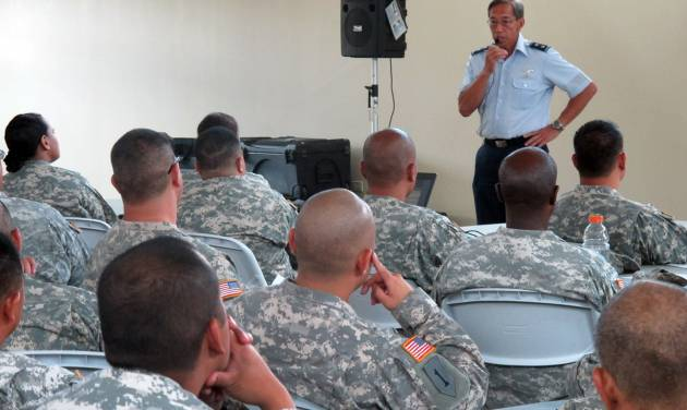 In this Monday, July 1, 2013 photo, Maj. Gen. Darryll Wong, Hawaii National Guard commander, speaks to soldiers and airmen about furloughs in Kapolei, Hawaii. More than 1,100 National Guard soldiers and airmen in Hawaii _and thousands in other states _ will be living with 20 percent less pay over the next three months as the Defense Department carries out automatic federal budget cuts. (AP Photo/Audrey McAvoy)