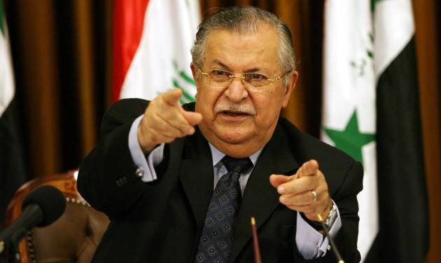 FILE - In this Friday, Aug. 17, 2007 file photo, Iraq's President Jalal Talabani talks to reporters in Baghdad, Iraq. A doctor who oversees Talabani's medical care when he is in Iraq, says the president, who is currently in Germany for treatment, is able to speak with and understand those around him more than two months after suffering a stroke. (AP Photo/ Hadi Mizban, File)