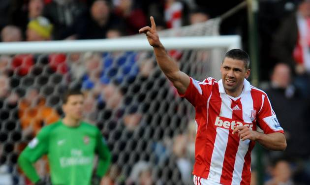Stoke's Jonathan Walters celebrates after scoring from the penalty spot against Arsenal during the English Premier League soccer match between Stoke City and Arsenal at Britannia Stadium in Stoke On Trent, England, Saturday, March 1, 2014. (AP Photo/Rui Vieira)