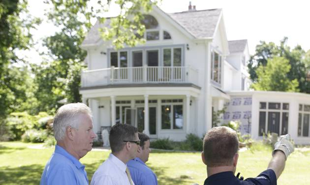 Law enforcement officers search the home of Dr. Timothy Jorden in Hamburg, N.Y., Thursday, June 14, 2012. Jorden is sought in connection with the hospital shooting death of his ex-girlfriend at Erie County Medical Center in Buffalo, N.Y. on Wednesday. (AP Photo/David Duprey)