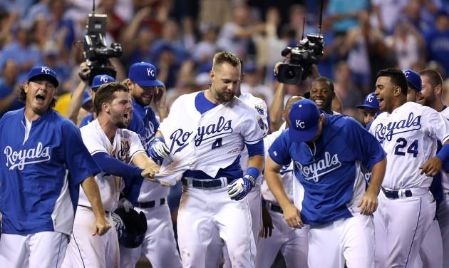ADVANCE FOR WEEKEND EDITIONS, AUG. 30-31 - FILE - In this Aug. 26, 2014, file photo, Kansas City Royals' Alex Gordon (4) celebrates with teammates after hitting a two-run walk-off home run during a baseball game against the Minnesota Twins  in Kansas City, Mo. The recipe for small-market success goes something like this: Develop your own talent, succeed with a couple of reclamation projects, find a few diamonds in the rough and make one or two big trades to put your over the top. The Royals have followed that process exactly, and that's why the franchise is staring down its first playoff appearance in nearly 30 years. (AP Photo/Ed Zurga, File)