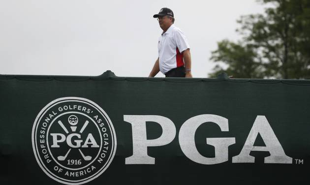 Kenny Perry walks on the bridge to the first tee during the final round of the PGA Championship golf tournament at Valhalla Golf Club on Sunday, Aug. 10, 2014, in Louisville, Ky. (AP Photo/Mike Groll)