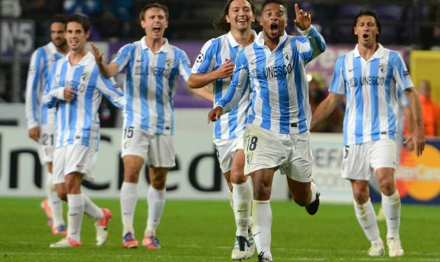 Spain's Malaga player Eliseu, 2nd right, celebrates with teammates after scoring against RSC Anderlecht during the Group C Champions League soccer match, in Brussels, Wednesday, Oct. 3, 2012. (AP Photo/Geert Vanden Wijngaert)