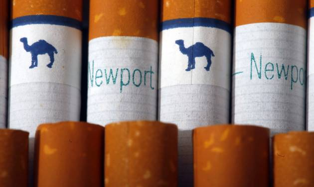 Camel, a Reynolds American brand, and Newport, a Lorillard brand, cigarettes are arranged for a photo Tuesday, July 15, 2014 in Philadelphia. Reynolds American Inc. is planning to buy rival Lorillard Inc. for about $25 billion in a deal to combine two of the nation's oldest and biggest tobacco companies, the companies announced Tuesday. (AP Photo/Matt Rourke)