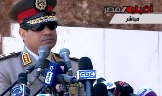 """In this image taken from Egypt State TV, Egyptian Defense Minister Gen. Abdel-Fattah el-Sissi delivers a speech in Alexandria, Egypt, Wednesday, July 24, 2013. El-Sissi has called on Egyptians to hold mass demonstrations to voice their support for the military to put an end to """"violence"""" and """"terrorism.""""( AP Photo/Egypt State TV)"""