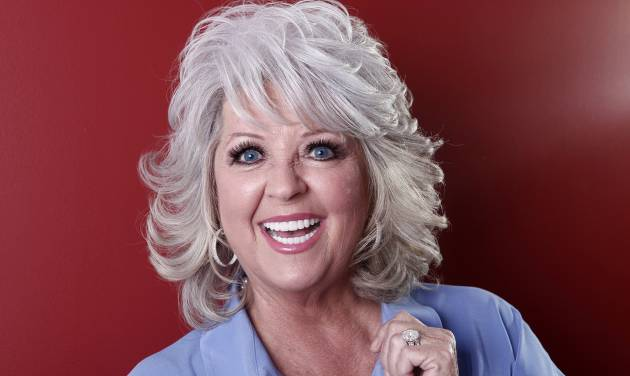 FILE - In this Jan. 17, 2012 file photo, celebrity chef Paula Deen poses for a portrait in New York. Lawyers signed a deal Friday, Aug. 23, 2013, to drop a discrimination and sexual harassment lawsuit against Deen, who was dropped by the Food Network and other business partners after she said under oath that she had used racial slurs in the past. (AP Photo/Carlo Allegri, File)