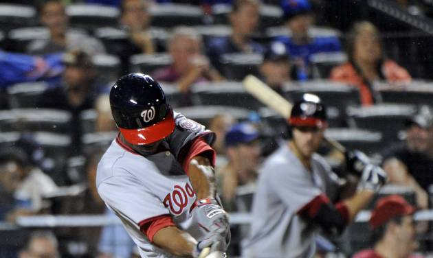 Washington Nationals' Michael A. Taylor hits a two-run home run during the sixth inning of a baseball game against the New York Mets Tuesday, Aug.12, 2014, at Citi Field in New York. It was Taylor's first career major league home run. (AP Photo/Bill Kostroun)