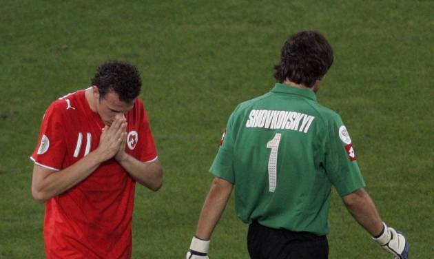 FILE - In this Monday, June 26, 2006 file photo, Switzerland's Marco Streller, left, reacts after missing a penalty kick against Ukraine's goalkeeper Oleksandr Shovkovskyi, during their World Cup second round soccer match, in Cologne, Germany. Ukraine won 3-0 in a penalty shootout. On this day: Switzerland became the first team in the history of World Cup shoot-outs not to score a single spot kick, and the first team ever to depart a World Cup without conceding a goal in normal play. (AP Photo/Martin Meissner, File)