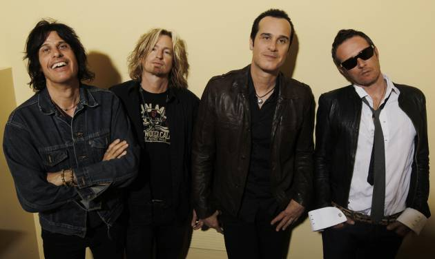 "FILE - This April 30, 2010 file photo shows the Stone Temple Pilots, from left, Dean Deleo, Eric Kretz, Robert Deleo, and Scott Weiland from the band Stone Temple Pilots, pose for a portrait in Santa Monica, Calif. In a one-sentence news release on Wednesday, Feb. 27, 2013, publicist Kymm Britton said: ""Stone Temple Pilots have announced they have officially terminated Scott Weiland."" No other information was provided. (AP Photo/Matt Sayles, file)"