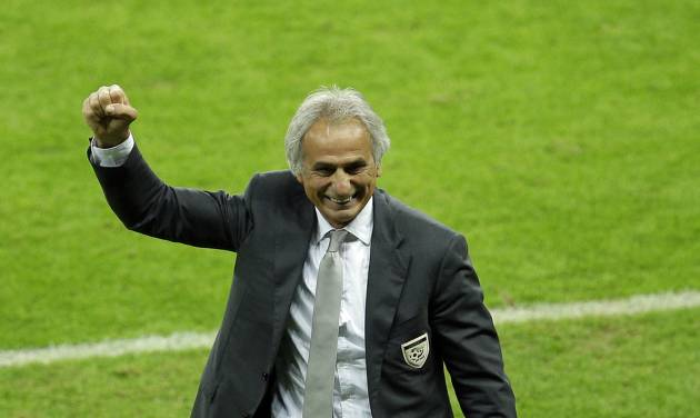 Algeria's head coach Vahid Halilhodzic celebrates after his side won the game 4-2 in the group H World Cup soccer match between South Korea and Algeria at the Estadio Beira-Rio in Porto Alegre, Brazil, Sunday, June 22, 2014. (AP Photo/Michael Sohn)