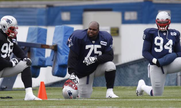New England Patriots defensive tackle Vince Wilfork (75) talks with defensive lineman Marcus Forston (98)  and defensive end Justin Francis (94)  during NFL football practice at the team's training facility in Foxborough, Mass., Wednesday, Nov. 28, 2012. (AP Photo/Stephan Savoia)