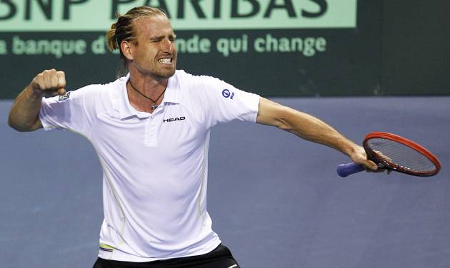 German tennis player Peter Gojowczyk celebrates after winning his single match against French player Jo-Wifried Tsonga, in the quarterfinals of the Davis Cup in Nancy, eastern France, Friday April 4, 2014. Germany leads 2-0 at the end of the first day..(AP Photo/Remy de la Mauviniere)