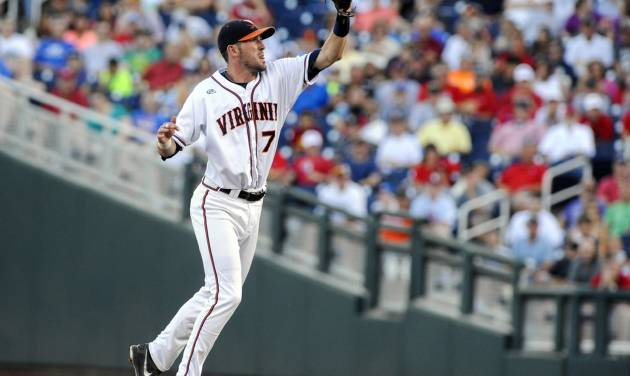 Virginia second baseman Branden Cogswell (7) leaps for a ball from catcher Nate Irving in the third inning of an NCAA baseball College World Series game in Omaha, Neb., Sunday, June 15, 2014. Mississippi's Errol Robinson was tagged out in a run down on the play.  (AP Photo/Eric Francis)