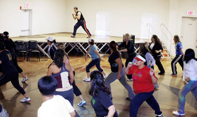Left: Instructor Jose Munoz leads a Zumba marathon at the Palacio del Sol in Oklahoma City. PHOTO BY PAUL HELLSTERN, THE OKLAHOMAN