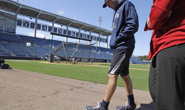 New York Yankees shortstop Derek Jeter, who is on the disabled list, walks gingerly on the field after doing an interview before the Yankees' spring training baseball game at Steinbrenner Field in Tampa, Fla., Tuesday, March 26, 2013. (AP Photo/Kathy Willens)