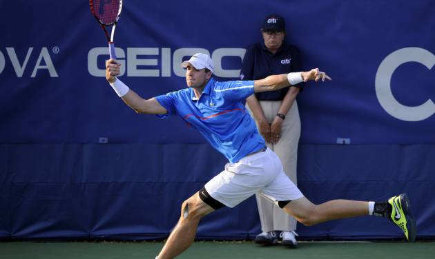 John Isner returns the ball against Steve Johnson during a match at the Citi Open tennis tournament, Wednesday, July 30, 2014, in Washington. (AP Photo/Nick Wass)