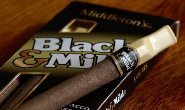 """This undated product image provided by Altria shows John Middleton Co.'s Black & Mild cigars. Under a Food and Drug Administration proposal to regulate cigars and other tobacco products the same as cigarettes, cigar makers would have to remove descriptions like """"light,"""" ''mild,"""" ''medium"""" or """"low"""" from their products, raising a unique question about the fate of Black & Mild. (AP Photo/Altria)"""
