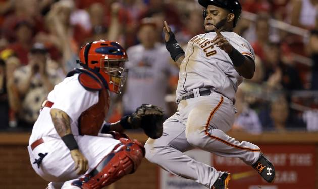 San Francisco Giants' Pablo Sandoval, right, scores on a two-run double by Michael Morse as St. Louis Cardinals catcher Yadier Molina looks for the throw during the eighth inning of a baseball game Thursday, May 29, 2014, in St. Louis. (AP Photo/Jeff Roberson)