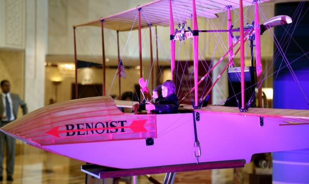 A model of the aircraft that made the historic trip a century ago is on display at the 70th International Air Transport Association (IATA) in Doha, Qatar, Monday, June 2, 2014. The aviation industry is marking 100 years since the first scheduled commercial flight took off, making a 23-minute journey across Florida's Tampa Bay. (AP Photo/Osama Faisal)
