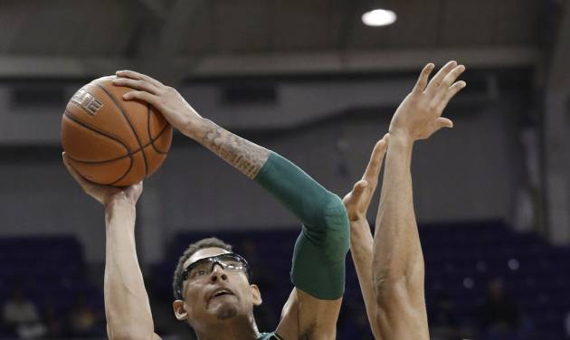 Baylor center Isaiah Austin (21) shoots against TCU forward Amric Fields (4) during the first half of an NCAA college basketball game Wednesday, Feb. 12, 2014, in Fort Worth, Texas. (AP Photo/LM Otero)