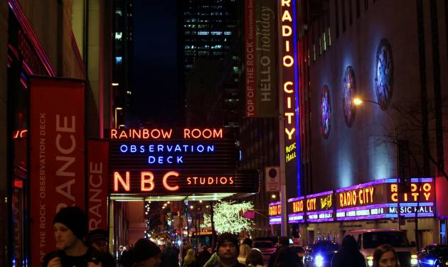 "FILE - In this Friday, Aug. 21, 2009, file photo, the NBC logo glows in neon lights among other iconic signs at its headquarters in New York. Comcast said Tuesday, Feb. 12, 2013, that it's buying General Electric's 49 percent stake in the NBCUniversal joint venture for $16.7 billion several years early, as the company takes advantage of low borrowing costs and what CEO Brian Roberts called a ""very attractive price.""  (AP Photo/Bebeto Matthews, File)"