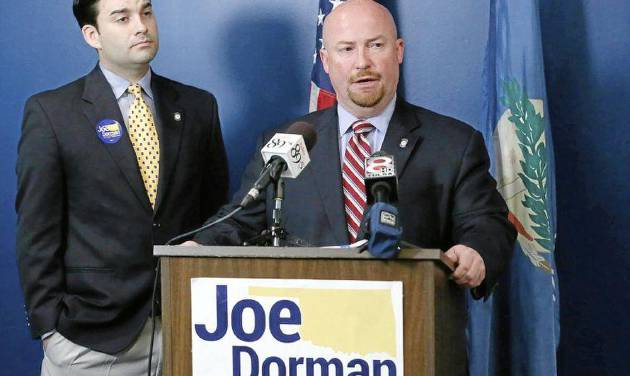 Democratic gubernatorial candidate Joe Dorman speaks at his campaign headquarters with Rep. Eric Proctor (left) in Tulsa, Okla. on Thursday, July 10, 2014. MATT BARNARD/Tulsa World