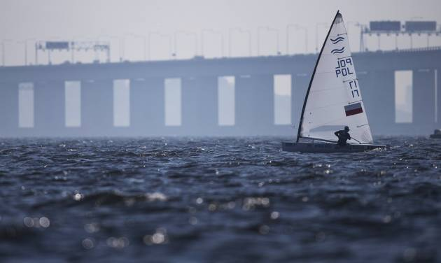Poland's Finn class Piotr Kula competes during the first test event for the Rio 2016 Olympic Games at the Guanabara Bay in Rio de Janeiro, Sunday, Aug. 3, 2014. American sailing officials have hired medical experts to test the water in Guanabara, which has suffered from decades of untreated human waste being poured into the bay. (AP Photo/Felipe Dana)