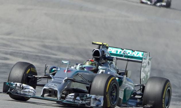 World Championships leader and Mercedes Formula One driver Nico Rosberg of Germany speeds during the free practice session at the German Formula One Grand Prix in Hockenheim, Germany, Friday, July 18, 2014. The German Grand Prix will be held on Sunday, July 20, 2014. (AP Photo/Jens Meyer)