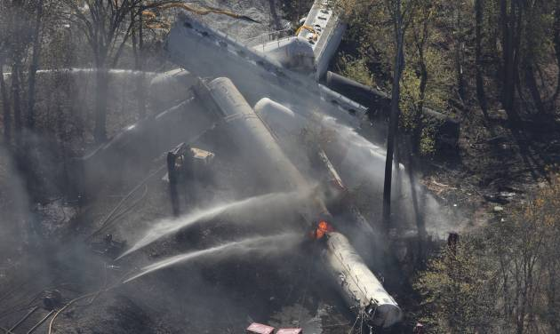 Flames can be seen from the air after an explosion happened at the sight of a train derailment in southern Jefferson County, just south of Louisville, Ky, Wednesday, Oct. 31, 2012. (AP Photo/The Courier-Journal, Sam Upshaw)
