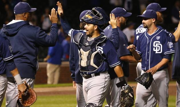 San Diego Padres catcher Rene Rivera, center, celebrates with teammates after the Padres' 13-3 win over the Chicago Cubs in a baseball game Thursday, July 24, 2014, in Chicago. (AP Photo/Charles Rex Arbogast)