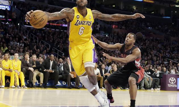 FILE - In this March 8, 2013, file photo, Los Angeles Lakers forward Earl Clark (6) saves the ball that was heading out of bounds as Toronto Raptors' Kyle Lowry defends during an NBA basketball game in Los Angeles. A person with knowledge of the negotiations says the Cleveland Cavaliers have reached agreement on a two-year contract with free agent forward Clark. Clark met for two days with the Cavs earlier this week. The deal is worth $9 million, said the person who spoke to the Associated Press on the condition of anonymity because NBA teams can't announce free-agent signings until July 10. (AP Photo/Reed Saxon, File)