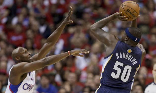 Memphis Grizzlies forward Zach Randolph shoots under pressure by Los Angeles Clippers forward Lamar Odom during the first half of Game 1 of a first-round NBA basketball playoff series Los Angeles, Saturday, April 20, 2013. (AP Photo/Chris Carlson)