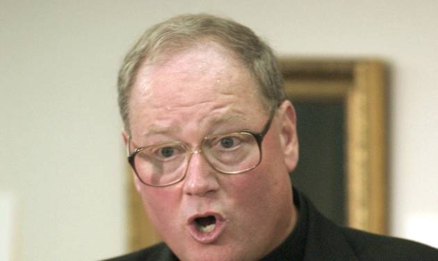 FILE - This Sept. 12, 2002 file photo file photo shows Milwaukee Archbishop Timothy Dolan in St. Francis, Wis. An Associated Press analysis of documents released in July 2013 found most of the $30 million the archdiocese paid out through mid-2012 went to clergy sex abuse victim settlements and therapy, but the bulk of it went to just a few victims - while hundreds of others got no money at all. Most of the settlements made public were reached as part of a mediation program Dolan started in 2003. (AP Photo/Darren Hauck, File)